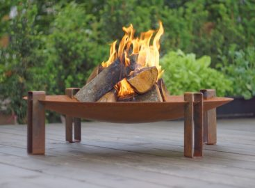 Alna rusting steel wood burning fire pit on the patio