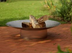 Curonian Gile Stainless Steel Wood Burning Fire Pit on the pavement