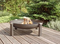 Tilsit wood burning rusting steel fire pit on the patio